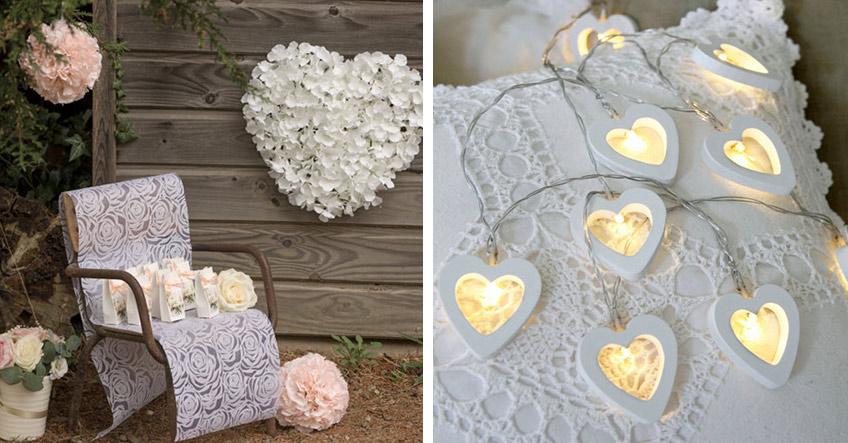 Herzen und Rosen schmücken romantisch die Hochzeitsfeier im ländlichen Stil